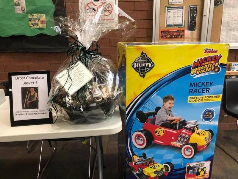Drost's chocolate basket, donated by Lisa Hill and her husband. Student Edgar Olivas donated a Mickey Mouse roadster racers.