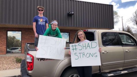 Julia Mewhinney, Carson and Emma Roithmayr show support by attending the welcoming of Shad Lewis parade in Delta, Colorado