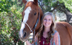 Senior at Delta High School, Kaitlyn Sharpe, poses with her horse Pica during senior photos.