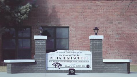 A new sign donated to Delta High School by the Alumni Association sits just outside the main entrance. Students had watched the sign's construction and development for over a week, but most students indicate that they don't understand the meaning of the sign, or why it was placed in this location now.