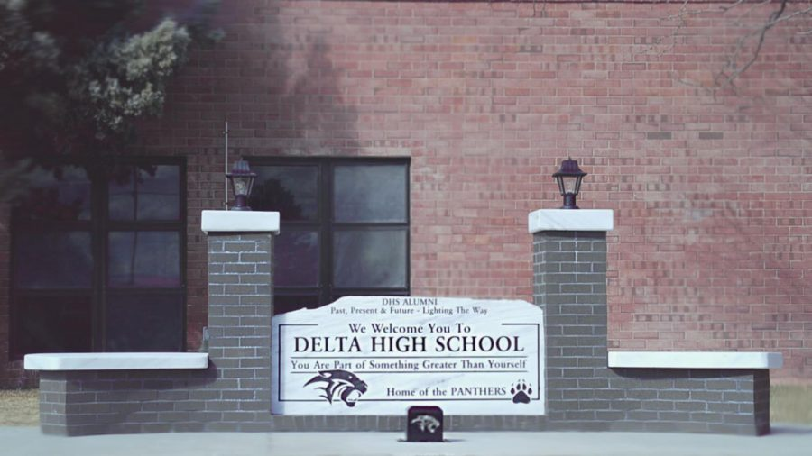A+new+sign+donated+to+Delta+High+School+by+the+Alumni+Association+sits+just+outside+the+main+entrance.+Students+had+watched+the+sign%E2%80%99s+construction+and+development+for+over+a+week%2C+but+most+students+indicate+that+they+don%E2%80%99t+understand+the+meaning+of+the+sign%2C+or+why+it+was+placed+in+this+location+now.